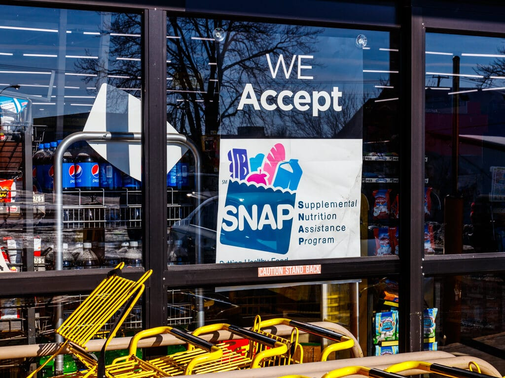 government assistance sign in grocery store window