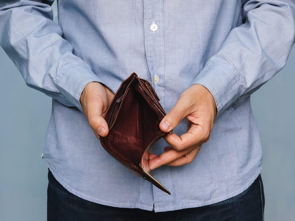 man opening empty wallet
