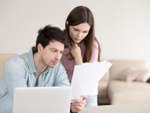 man and woman looking over legal documents