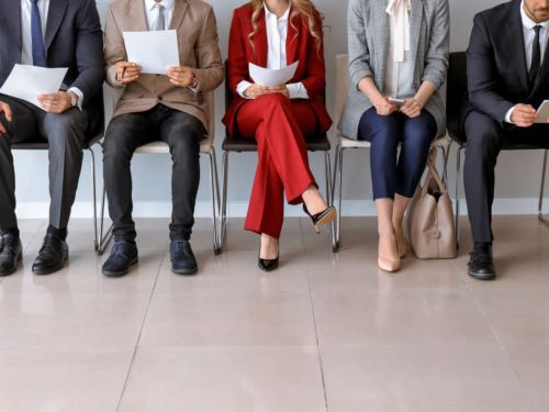 group of business professionals waiting for a job interview