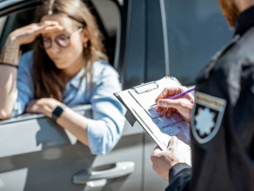 woman being pulled over for traffic violation