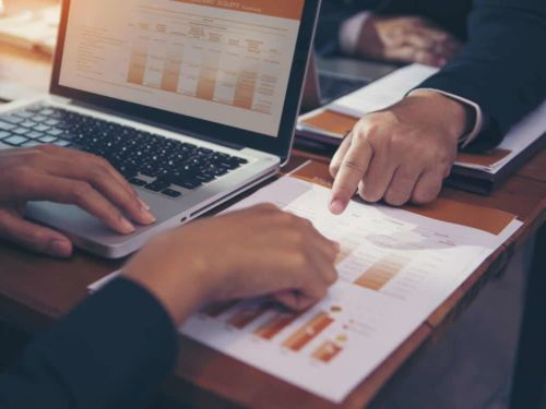 financial industry employees reviewing documents