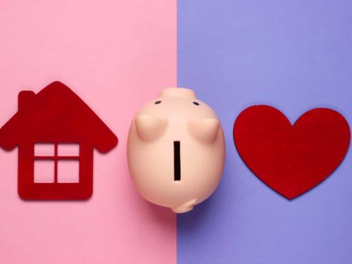 piggy bank in between a home and a heart
