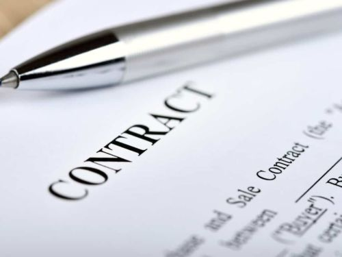 contract document and pen